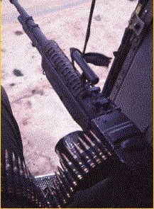 M-60 machine gun in use as a helicopter door gun. Note empty C-ration can